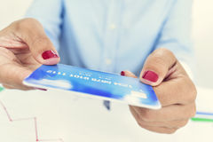 Young woman with a credit card in her hands Royalty Free Stock Photos