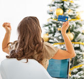 Young woman with credit card and laptop rejoicing success Stock Images