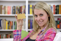 Young woman with credit card smiling Stock Photography