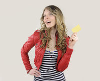 Young woman with credit or gift card Royalty Free Stock Photos