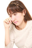 Young woman cries. Studio shot of young woman on white background Royalty Free Stock Photos