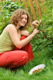 Young woman with crop of red currant Stock Images