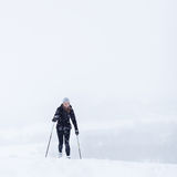Young woman cross-country skiing on a snow Royalty Free Stock Image