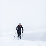 Young woman cross-country skiing on a snow Stock Photo