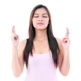 Young Woman Crossing Her Fingers Stock Photography