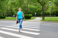Young woman crossing road Stock Photography