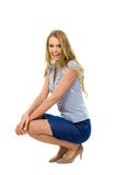 Young woman crouching Stock Images