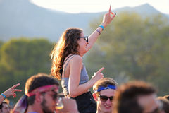 Young woman from the crowd cheering at FIB Festival Stock Image