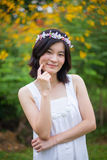 Young woman with a crown of flowers Stock Photo