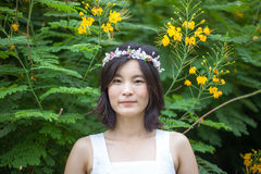 Young woman with a crown of flowers Royalty Free Stock Photo