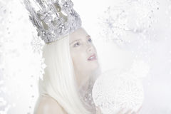 Young woman with crown and white cristmas ball Royalty Free Stock Photography