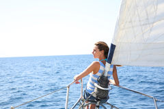Young woman cruising with sailing boat Royalty Free Stock Image