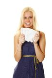 Young woman crumples paper Royalty Free Stock Image
