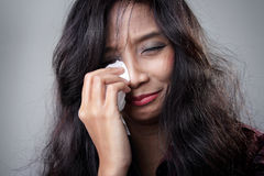 Young woman crying in despair Royalty Free Stock Images