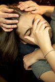 Young woman crying held and comforted by mother love problems Stock Photos