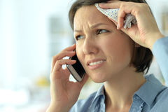 Young woman crying in phone Royalty Free Stock Photos