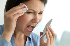 Young woman crying in phone Stock Photo