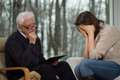 Young woman crying during therapy Stock Photos
