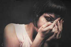 Free Young Woman Crying With Her Hands In Her Face. Domestic Violence. Drained Makeup Stock Photo - 183619050