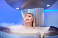 Young woman in a cryo sauna chamber Stock Photos