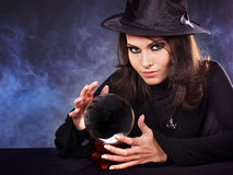 Young woman with crystal ball. Stock Image