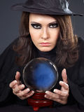 Young woman with crystal ball. stock images