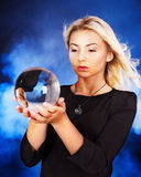 Young woman with crystal ball. royalty free stock image
