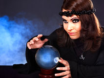 Young woman with crystal ball. Stock Photography
