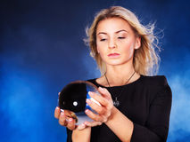 Young woman with crystal ball. Royalty Free Stock Photos