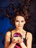 Young woman  with crystal ball. Halloween Royalty Free Stock Images