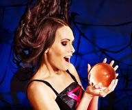 Young woman with crystal ball. Halloween Royalty Free Stock Photography