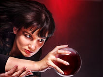 Young woman with crystal ball. Beauty and fashion Royalty Free Stock Photography