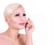 Young woman with crystal decorated lips isolated Royalty Free Stock Photos