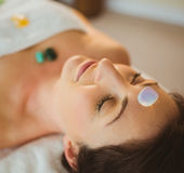 Young woman at crystal healing session. In therapy room Stock Photography