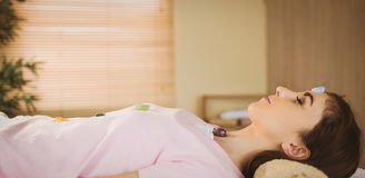 Young woman at crystal healing session. In therapy room Royalty Free Stock Photos
