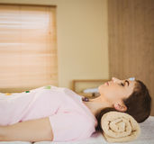 Young woman at crystal healing session. In therapy room Royalty Free Stock Photo