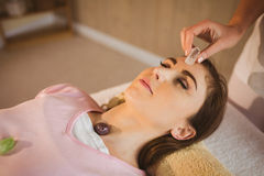 Young woman at crystal healing session. Young women at crystal healing session in therapy room Stock Images