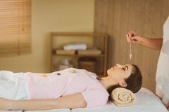Young woman at crystal healing session Royalty Free Stock Images