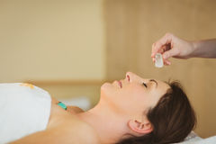 Young woman at crystal healing session. Young women at crystal healing session in therapy room Royalty Free Stock Photos