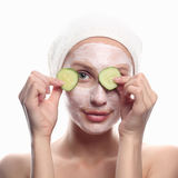 Young woman with cucumber mask Royalty Free Stock Images