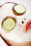 Young woman with cucumber slices on the face Royalty Free Stock Photo