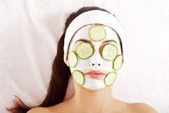 Young woman with cucumber slices on the face Stock Photos