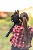 Young woman cuddle  with French Bulldog puppy.  Royalty Free Stock Images