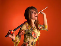 Young woman with cue Stock Image