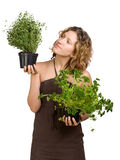 Young woman with culinary plants Stock Photos