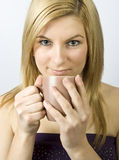 Young woman with cup Stock Images