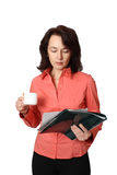 The young woman with a cup. The business woman with documents holds a white cup Stock Photography