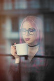 Young woman with cup Royalty Free Stock Image
