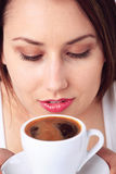 Young woman and a cup of coffee Stock Images