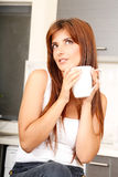 Young woman with a cup of coffee Stock Image